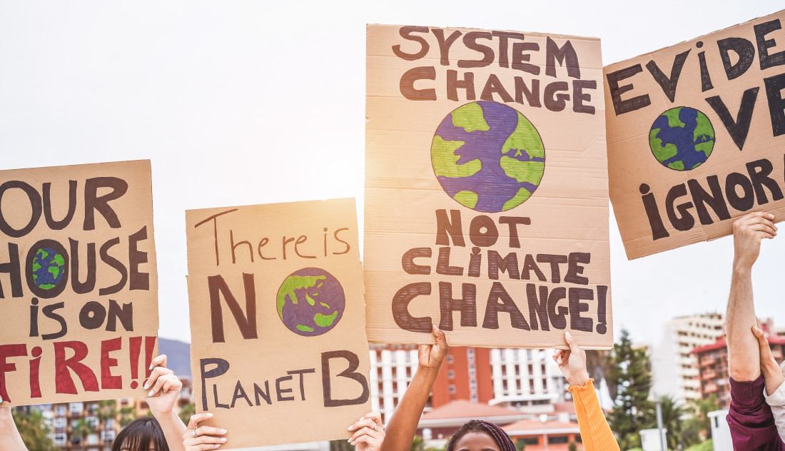 Group of demonstrators on road, young people from different culture and race fight for climate change - Global warming and environment concept