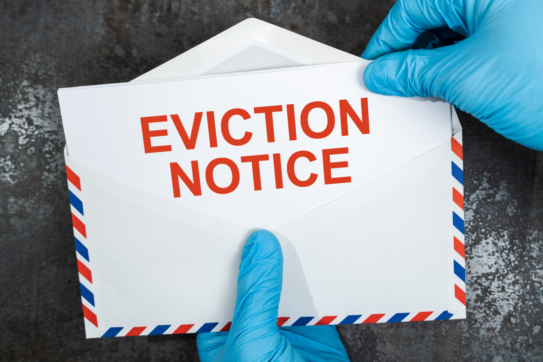 Eviction notice in red letters on white envelope