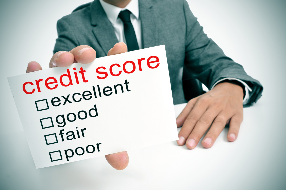 Businessman holding credit score card