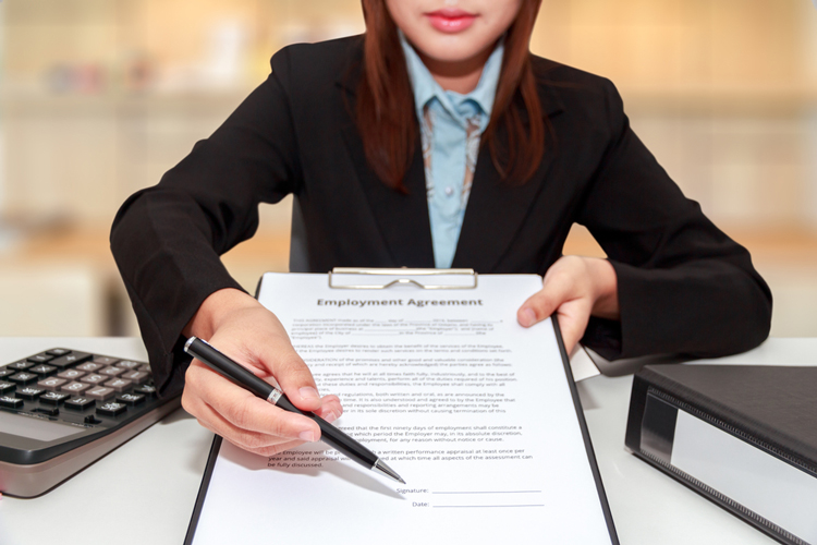 Business Woman Handing Over Contract for Signature