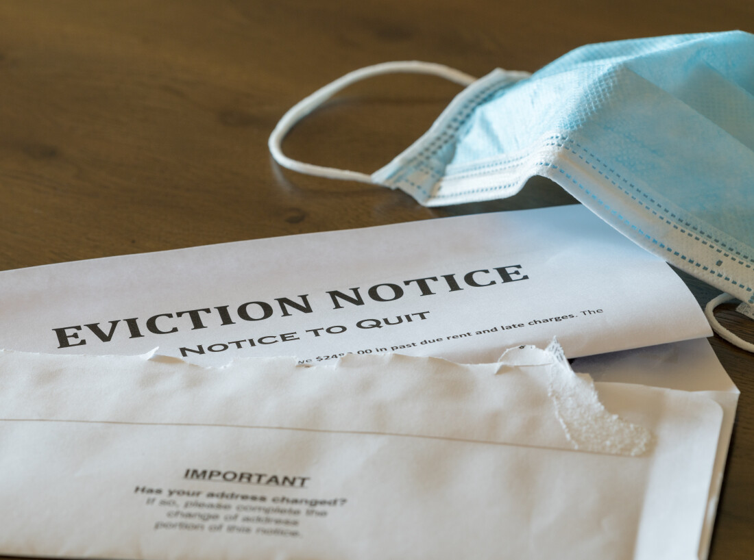 Eviction notice on table next to facemask