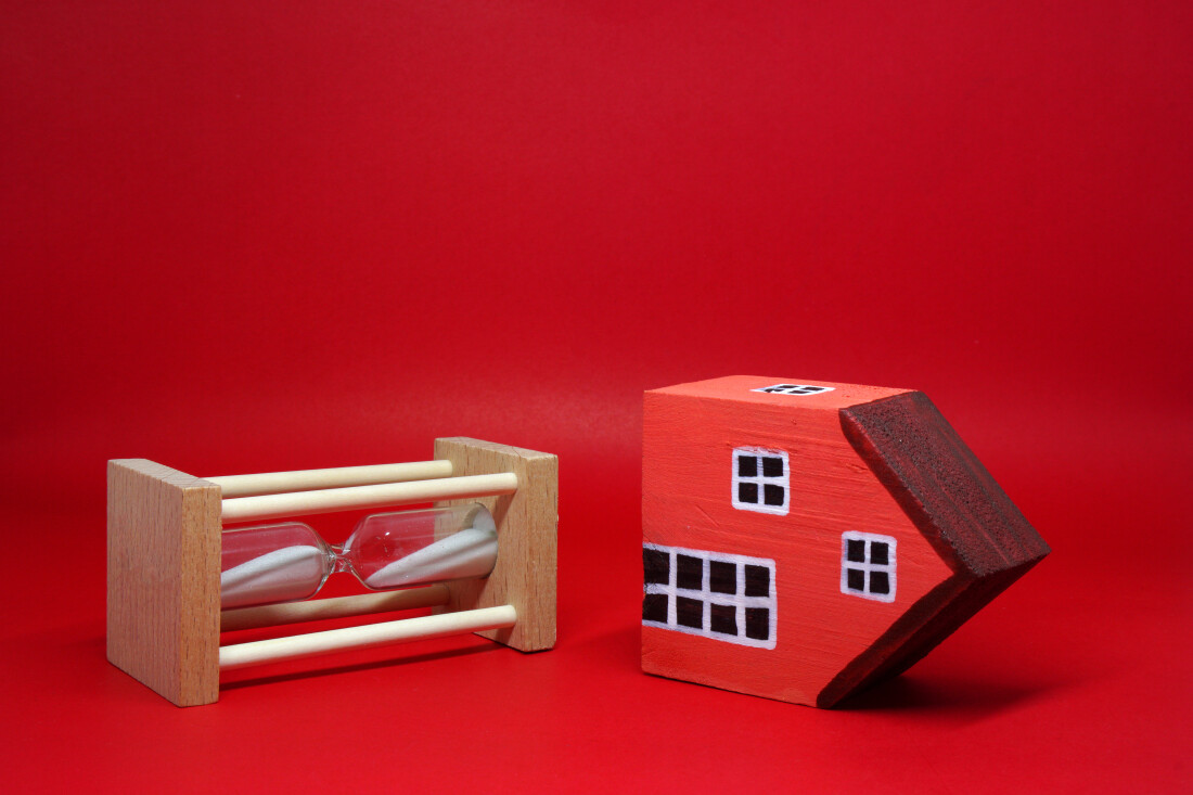 Red House on its side next to sand clock