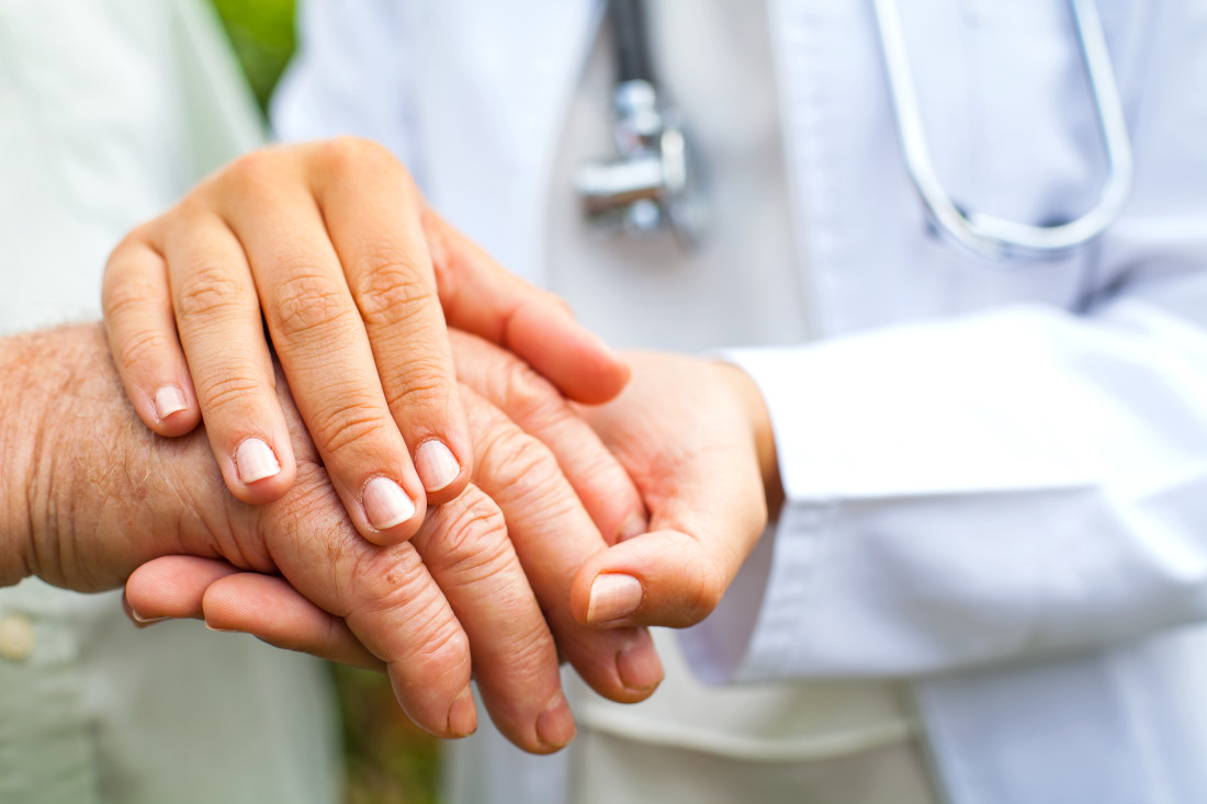 Doctor Holding Hand of Elderly Patient