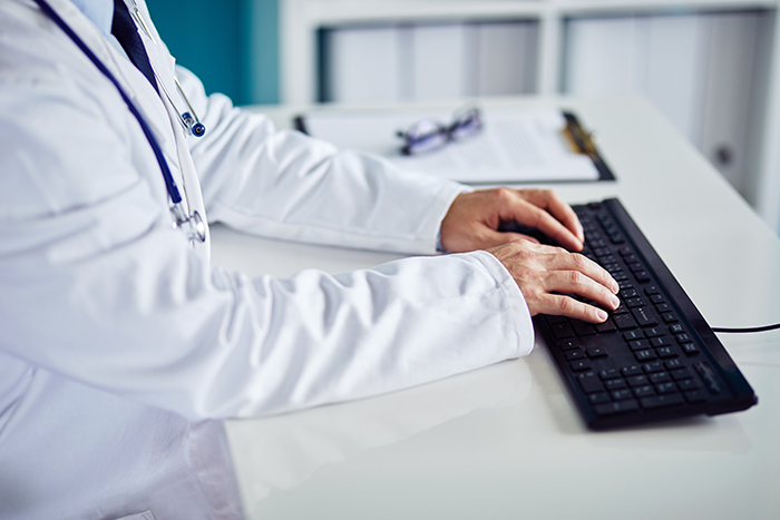 Doctor Typing on Keyboard
