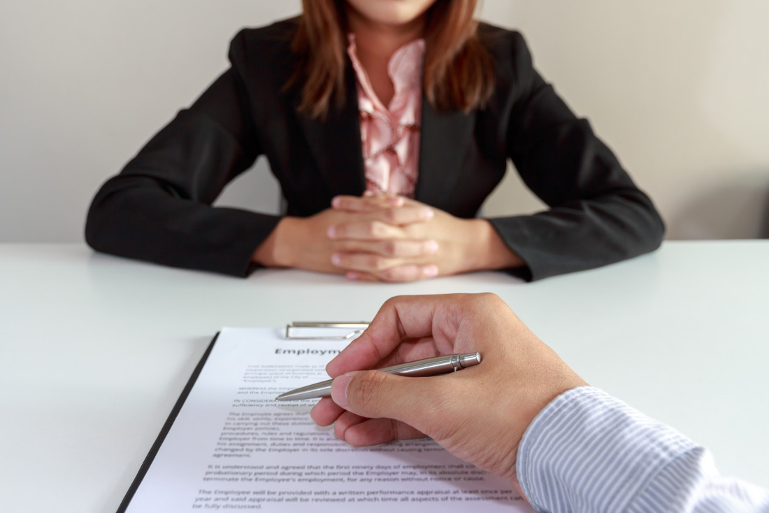 Employee Signing a Contract
