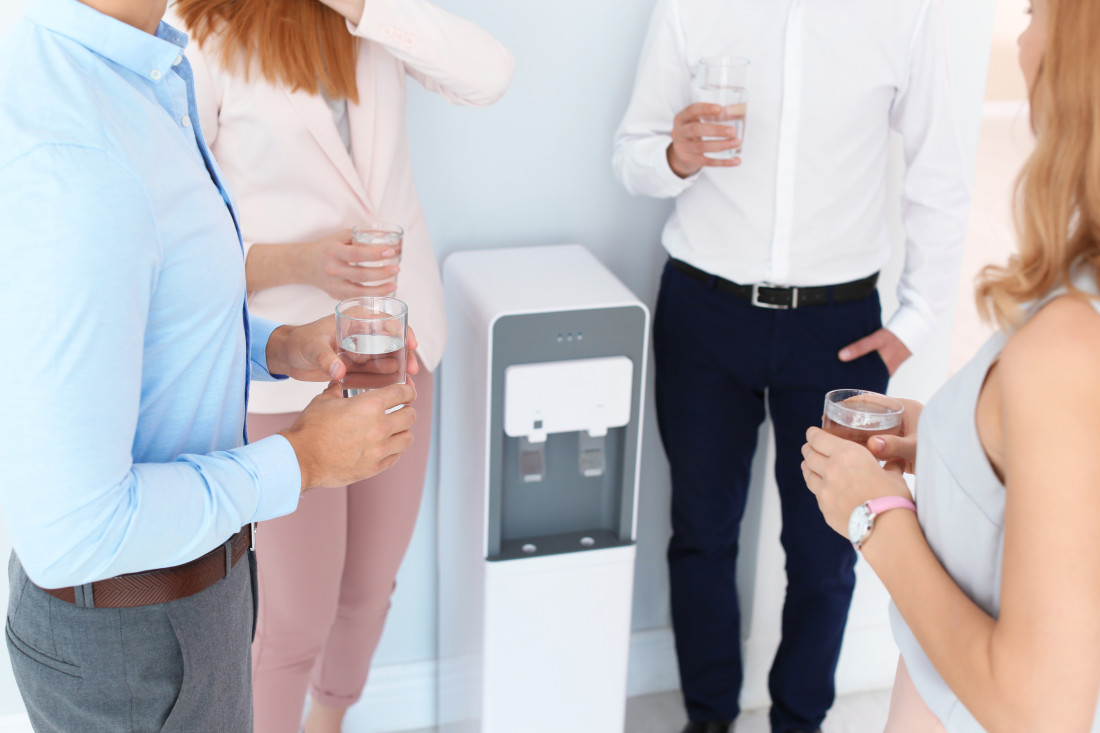 Employees around a water cooler
