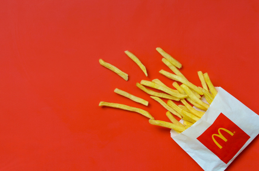 McDonald's french fries in small paperbag on bright red background | Photo by mehaniq41 - stock.adobe.com